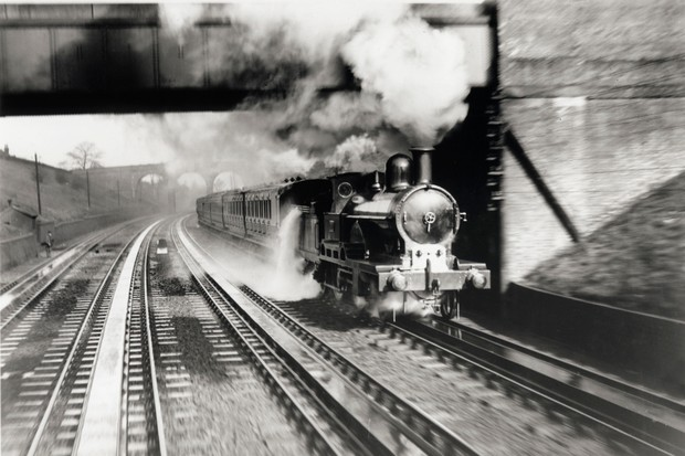 The London & North Western Railway locomotive Jeanie Deans picking up water at Bushey Troughs, 1899. (Photo by SSPL/Getty Images)