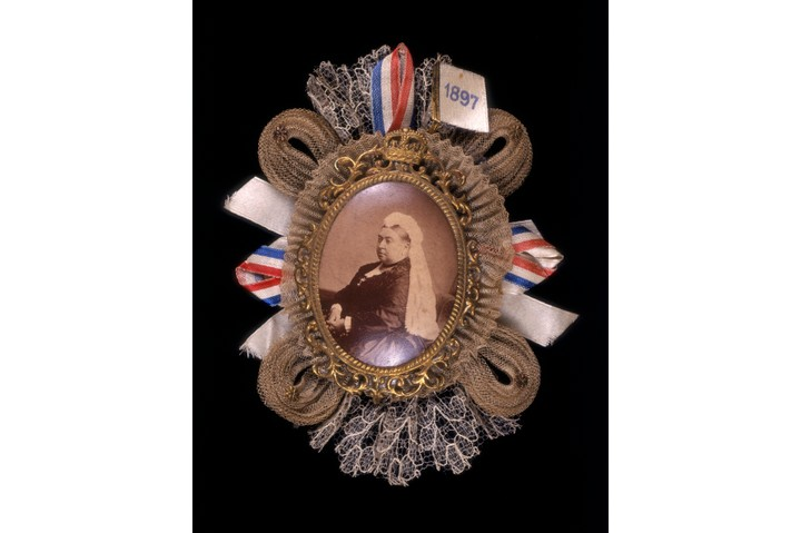 A brooch commemorating Queen Victoria's diamond jubilee in 1897. Queen Victoria is surrounded by a gold frame, ribbons and laces. (Photo by Museum of London/Heritage Images/Getty Images)