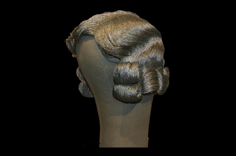 Photo of a blonde wig with curls