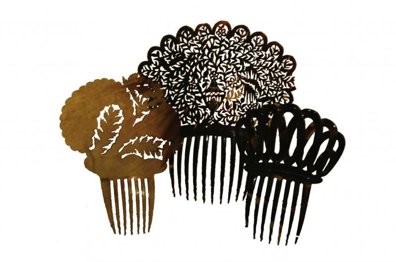 Photo of three Victorian hair combs