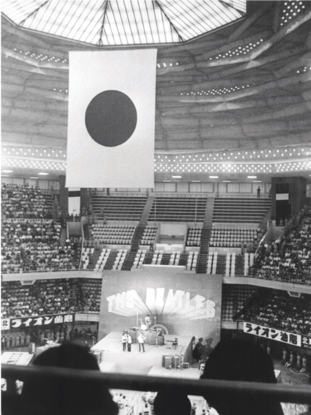 The Beatles performing in the Budokan Hall, Tokyo, Japan. 7th July 1966