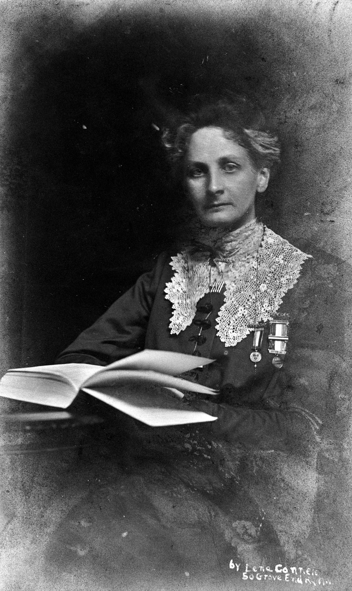 Suffragette, Lady Constance Lytton wearing a prison number badge and hunger strike medal, c1912. Lytton became involved with the women's suffrage movement in her late thirties, and was first arrested for joining a protest demonstration in February 1909. Having been sentenced to four weeks in Holloway, she was confined to the prison hospital with an alleged heart condition, but soon suspected that she was being given preferential treatment because of her social rank. Her treatment in Newcastle prison following a second arrest in October of the same year confirmed her suspicions: after a 56-hour hunger strike she was not forcibly fed, like other suffragettes, but examined by a heart specialist and allowed to go free. The following year, at a protest demonstration in Liverpool, Lytton disguised herself as a working-class woman and gave the false name of Jane Warton when she was arrested. This time she suffered the same treatment as the other suffragettes in prison. In 1912 she suffered a stroke and remained an invalid for the rest of her life. Suffragette, Lady Constance Lytton wearing a prison number Credit: Museum of London / HIP / TopFoto