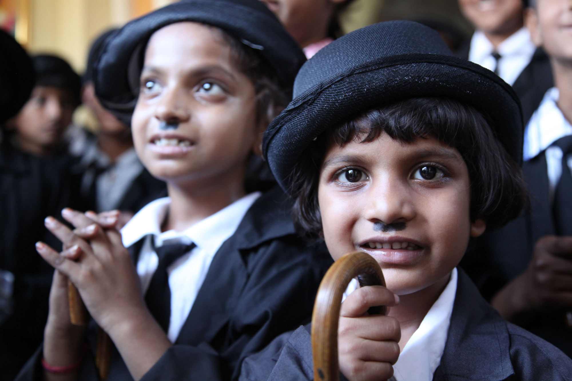 Programme Name: Dangerous Borders: A Journey across India & Pakistan - TX: n/a - Episode: n/a (No. 1) - Picture Shows: Children at the annual Charlie Chaplin Parade - Adipur, India.   - (C) October Films - Photographer: Production