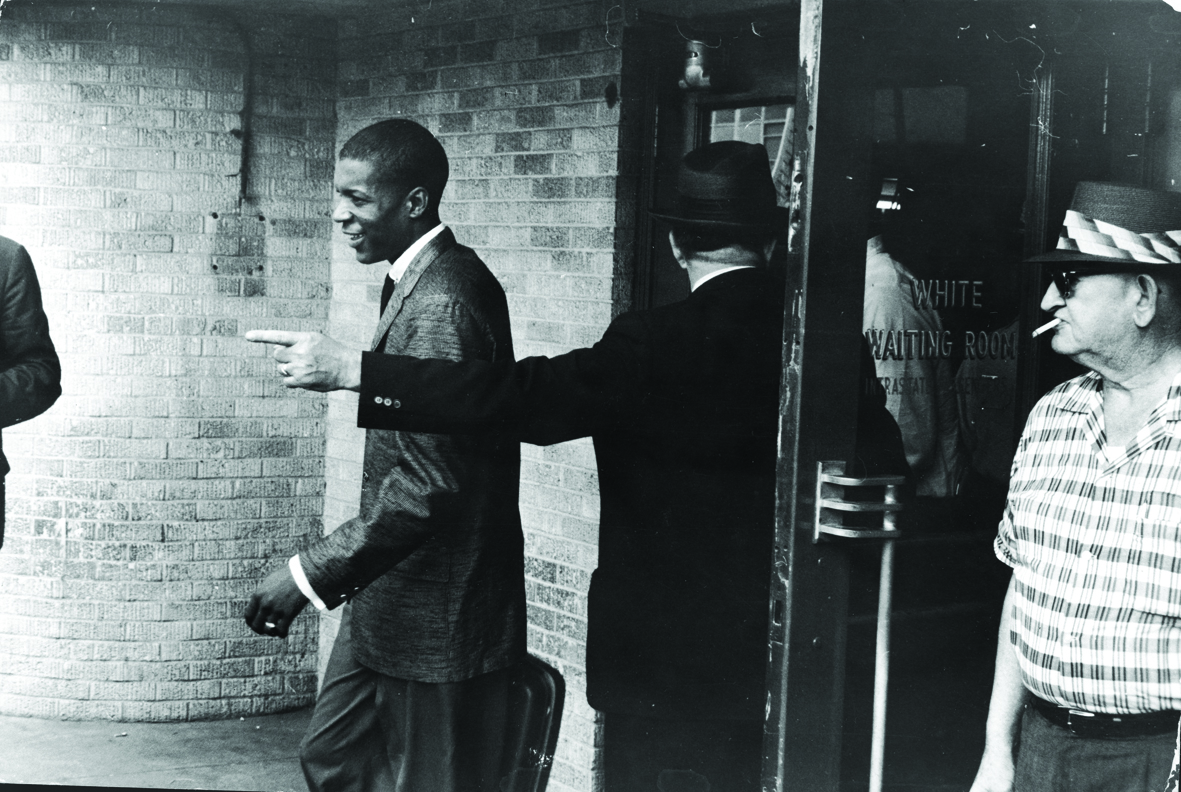 An unidentified young Black 'Freedom Rider' is told to leave a segregated 'white' waiting room at a bus depot in Jackson, Mississippi, May 26, 1961. The Freedom Riders traveled from Montgomery, Alabama to Mississippi to protest segregation in public bus depots. (Photo by Express Newspapers/Getty Images)