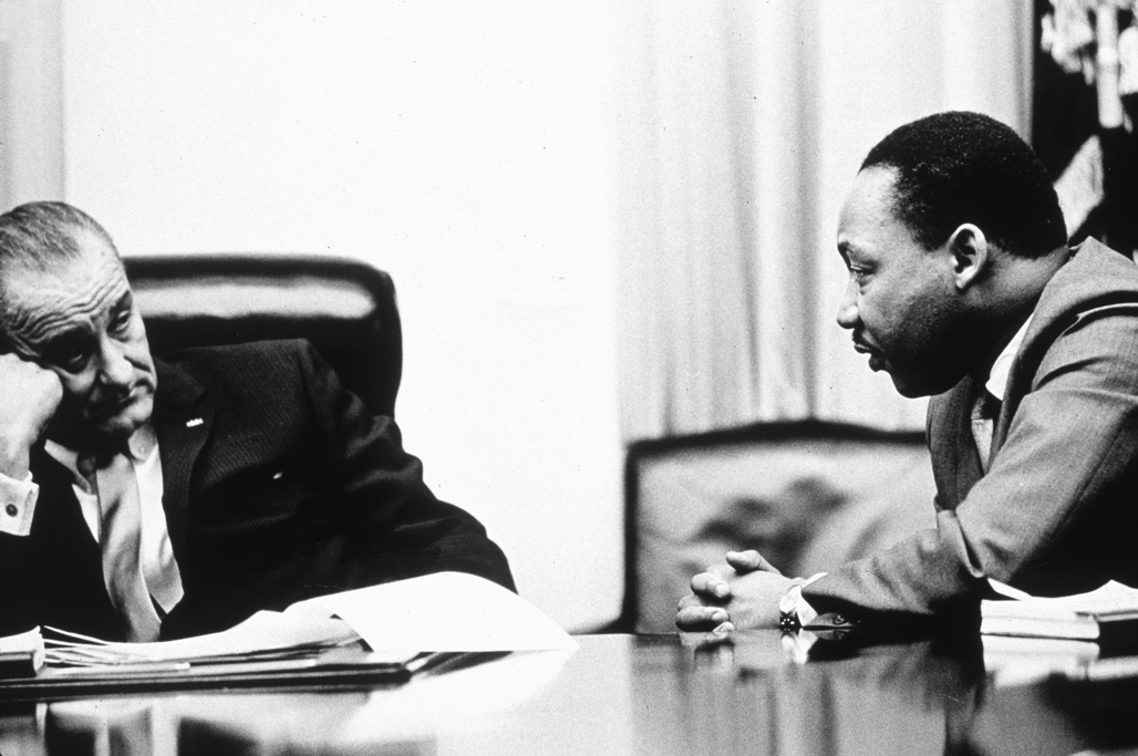 President Lyndon B Johnson (1908 - 1973) discusses the Voting Rights Act with civil rights campaigner Martin Luther King Jr. (1929 - 1968). The act, part of President Johnson's 'Great Society' program trebled the number of black voters in the south, who had previously been hindered by racially inspired laws, 1965. (Photo by Hulton Archive/Getty Images)