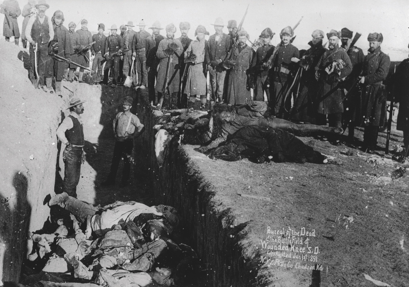 DPL480757 Bureal (burial) of the dead at the battlefield of Wounded Knee, South Dakota, 1891 (b/w photo) by American Photographer, (19th century); Denver Public Library, Western History Collection; (add.info.: The Wounded Knee Massacre happened on December 29, 1890, near Wounded Knee Creek.); American,  out of copyright