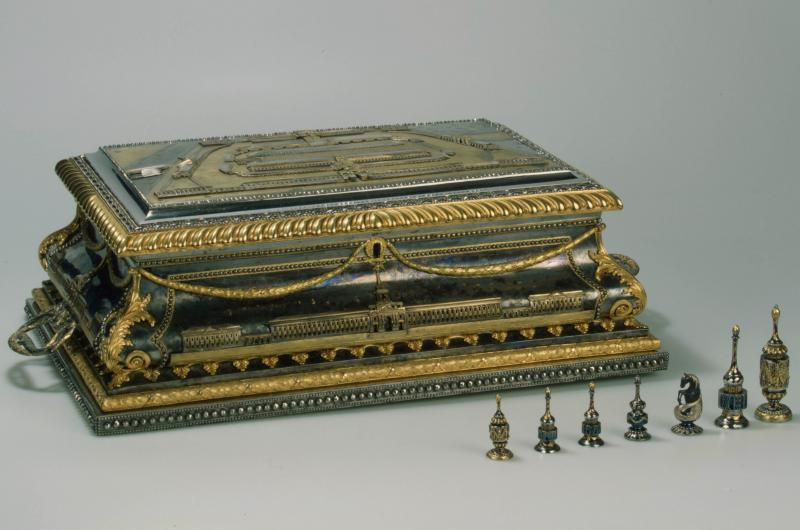 A box and chess pieces from the 18th century