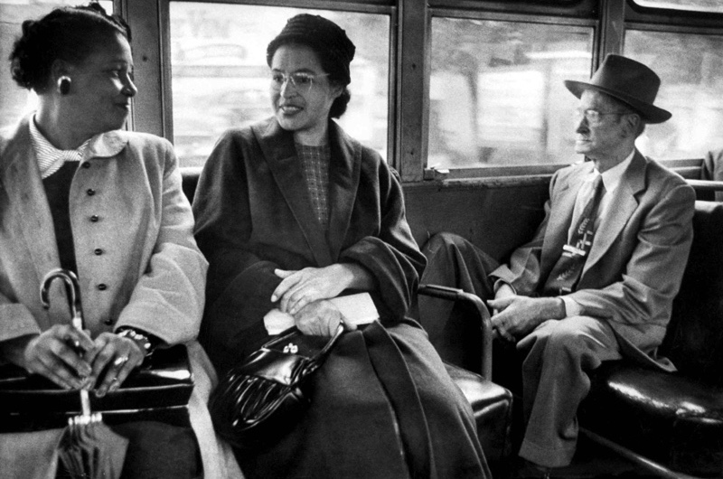 Rosa Parks (C) riding on newly integrated bus following Supreme Court ruling ending successful 381 day boycott of segragated buses. Boycott began when Parks was arrested for refusing to give up her seat to a white person.  (Photo by Don Cravens//Time Life Pictures/Getty Images)