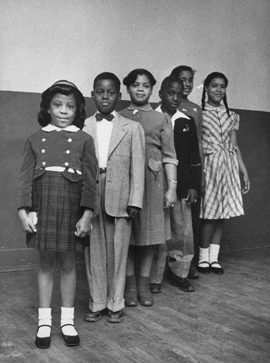 Portrait of the children involved in the landmark Civil Rights lawsuit 'Brown V. Board of Education,' which challenged the legality of American public school segregation, Topeka, Kansas, 1953. From front, Vicki Henderson, Donald Henderson, Linda Brown (the 'Brown' of the case's name), James Emanuel, Nancy Todd, and Katherine Carper. (Photo by Carl Iwasaki/Time Life Pictures/Getty Images)