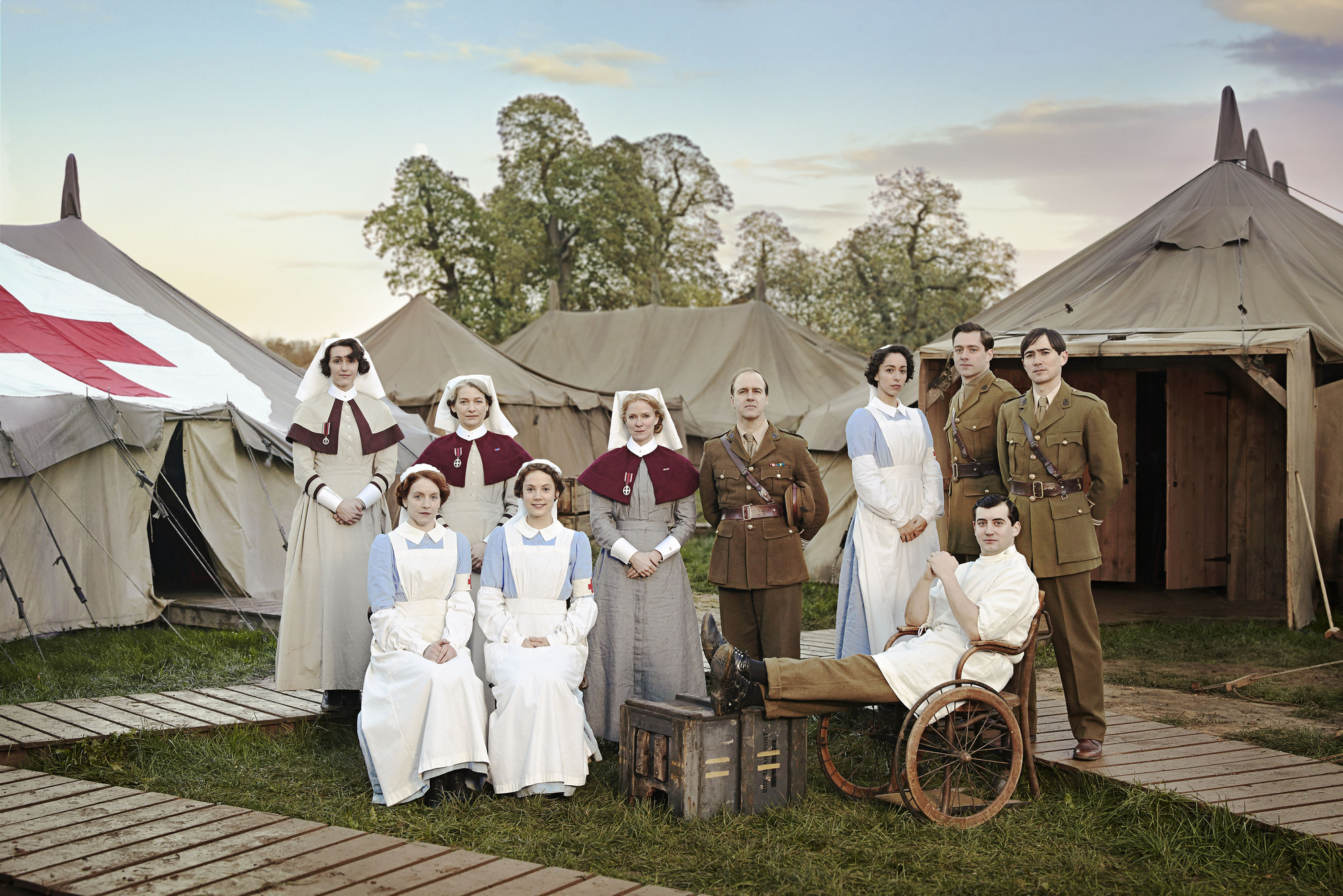 Programme Name: The Crimson Field - TX: n/a - Episode: Generics (No. n/a) - Picture Shows: (c/w from back left) Sister Joan Livesey (SURANNE JONES), Sister Margaret Quayle (KERRY FOX), Matron Grace Carter (HERMIONE NORRIS), Lieutenant-Colonel Roland Brett (KEVIN DOYLE), Kitty Trevelyan (OONA CHAPLIN), Captain Thomas Gillan (RICHARD RANKIN), Captain Miles Hesketh-Thorne (ALEX WYNDHAM), Corporal Peter Foley (JACK GORDON), Flora Marshall (ALICE ST CLAIR), Rosalie Berwick (MARIANNE OLDHAM) - (C) BBC - Photographer: Todd Anthony