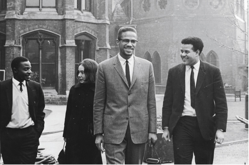 "United they stand Malcolm X chats with Eric Abrahams – the Oxford Union president who vowed to ""fill the room with blacks"" – before giving his famous address on 3 December 1964. (Getty)"