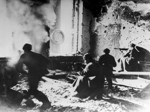 Russian soldiers target the Germans from within an abandoned building during the battle of Stalingrad, c1942
