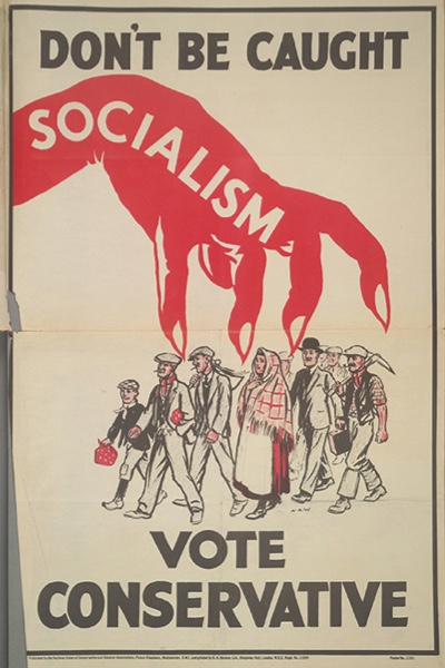 A poster for the British Conservative Party from the 1929 General Election. It depicts the clawed red hand of Socialism menacing a group of workers with the caption 'Don't be caught. Vote Conservative'. Artwork by (Photo by The Conservative Party Archive/Getty Images)