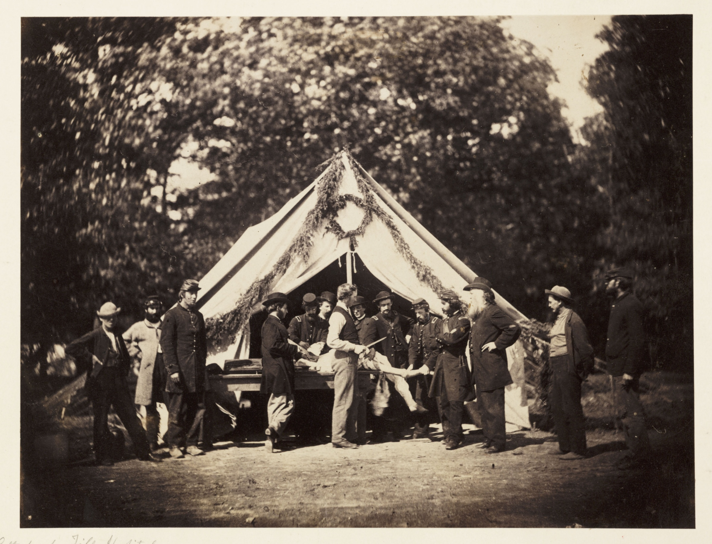 A20Union20Army20hospital20tent20on20the20battlefield20at20Gettysburg2C20July201863.20An20injured20man20lies20on20a20table20while20the20surgeon20stands20nearby20with20a20knife-f931fac