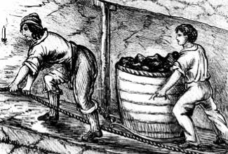 BBY5PG Woman and boy underground in coal mine drawing cart containing 3-4 cwt of coal - Bolton Lancashire From Matthias Dunn A Treatise