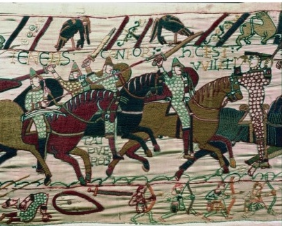 The charging Norman cavalry shown in glorious technicolour at the battle of Hastings in this masterpiece of storytelling. (Art Archive)
