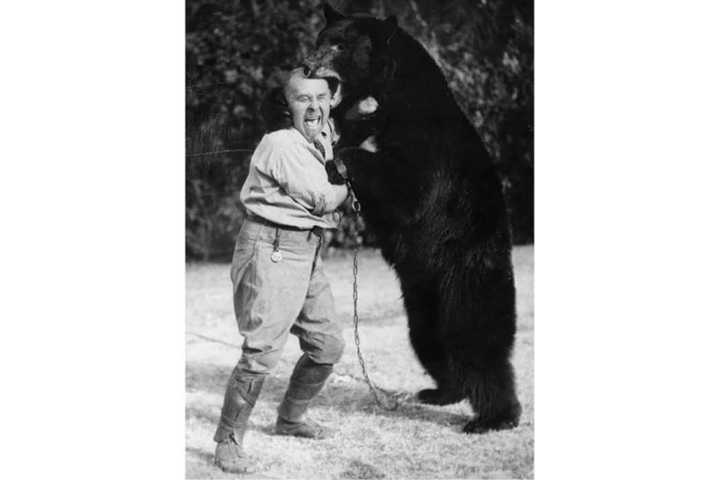 c1930: a man wrestles his tamed bear. (Photo by Imagno/Getty Images)