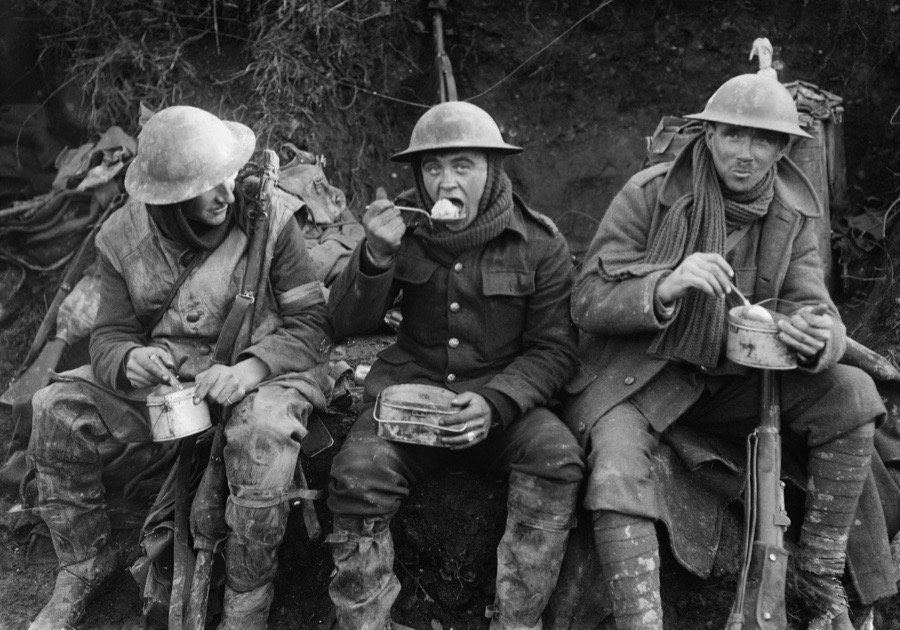 Ministry Of Information First World War Official Collection, British soldiers eating hot rations in the Ancre Valley during the Battle of the Somme, October 1916. (Photo by Lt. E Brooks/ IWM via Getty Images)