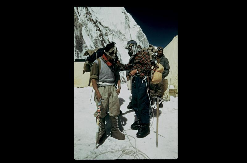 Edmund Hillary and Tenzing Norway check their equipment