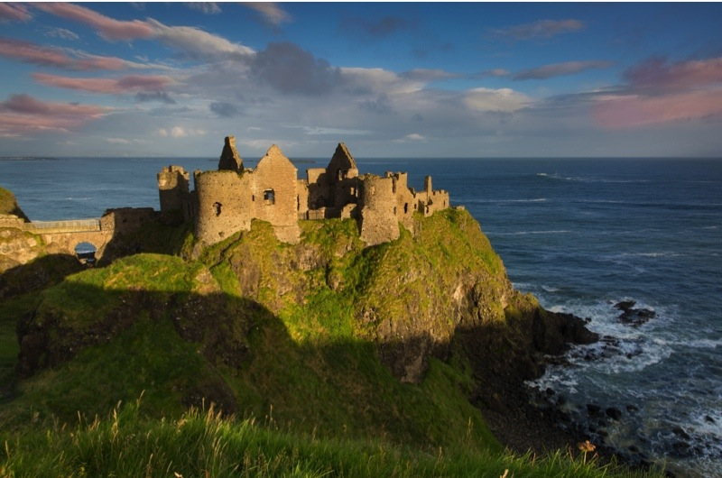 F2PPYC Sunrise over Dunluce Castle along northern coast of County Antrim, Northern Ireland, UK. Image shot 2015. Exact date unknown.
