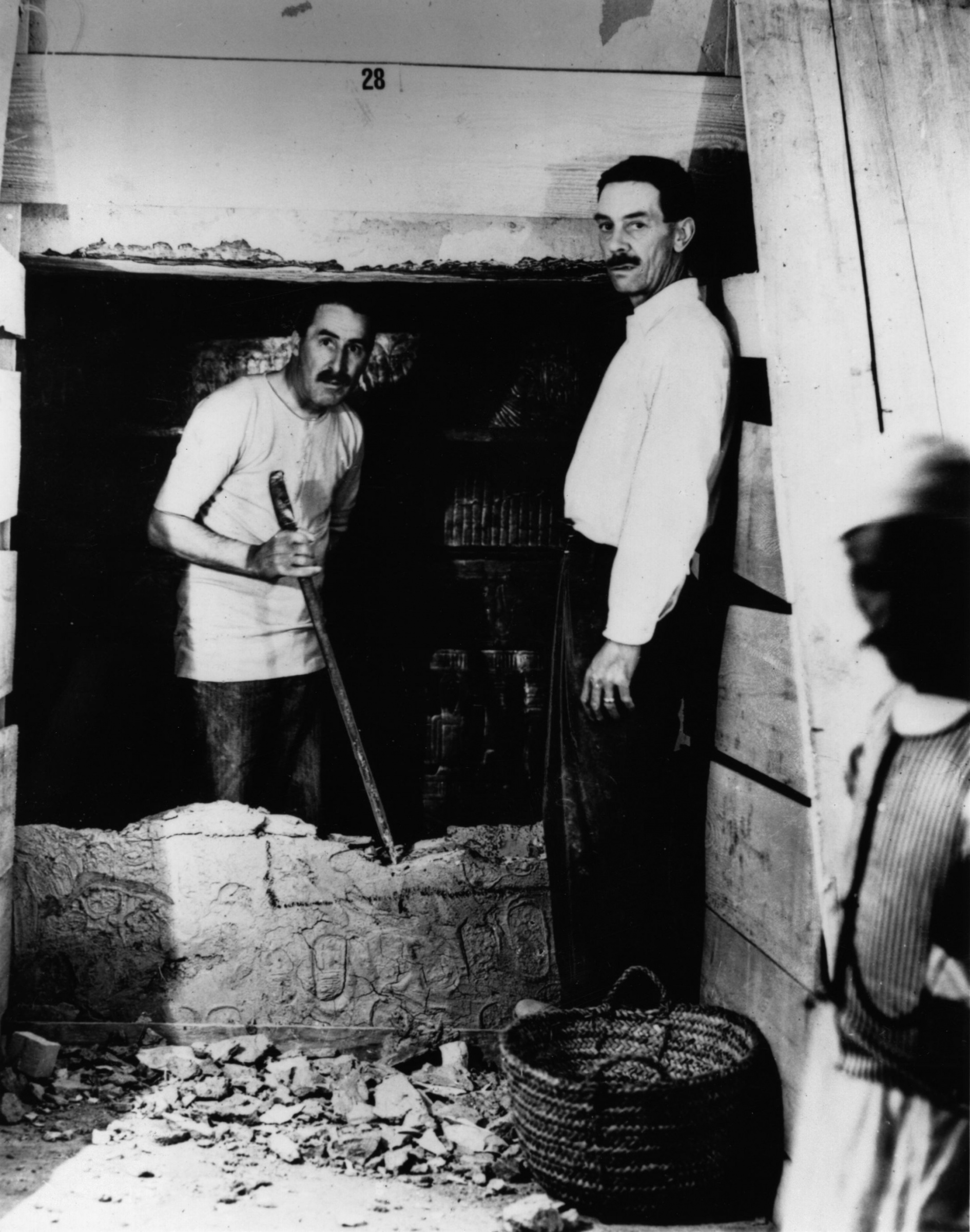 English egyptologist Howard Carter and Mr Mace opening the wall of the inner chamber of Tutankhamun's tomb, 1922
