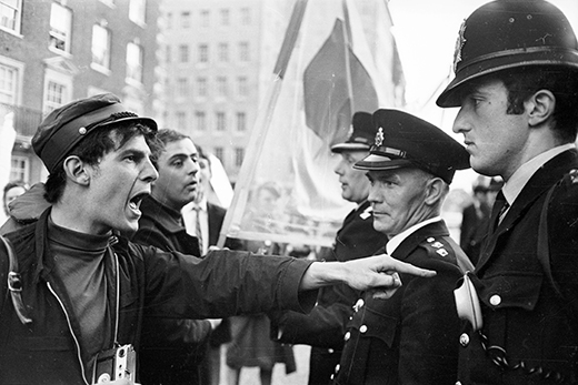 29th June 1966:  The police submit to a vehement haranguing from a protestor at an anti-Vietnam War demonstration in Grosvenor Square, London.  (Photo by Clive Limpkin/Express/Getty Images)
