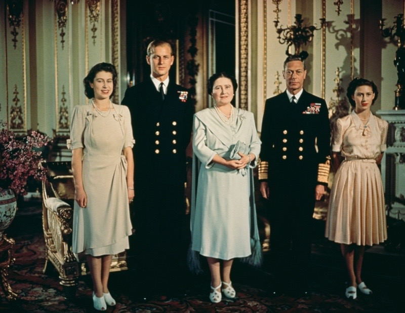 A portrait of the British royal family in the state apartments at Buckingham Palace to mark the engagement of Princess Elizabeth (later Queen Elizabeth II) and Philip Mountbatten (later Duke of Edinburgh), July 1947. Left to right: Princess Elizabeth, Philip Mountbatten, Queen Elizabeth the Queen Mother (1900 - 2002), King George VI (1895 - 1952) and Princess Margaret (1930 - 2002). (Photo by Popperfoto/Getty Images)