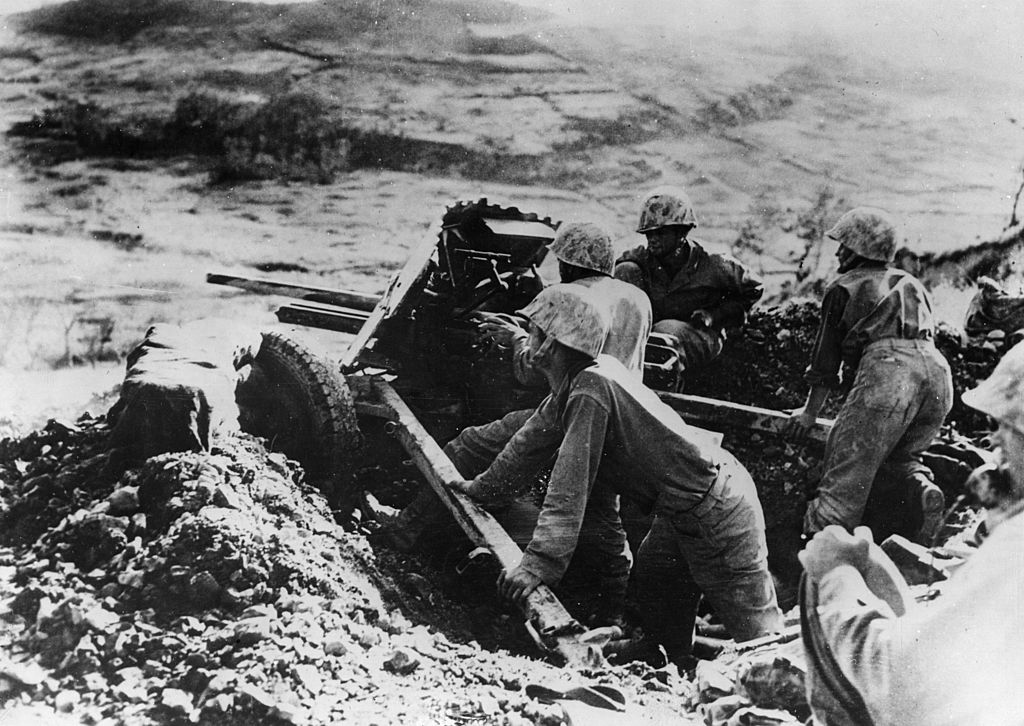 8th June 1945: On the slope of a hill on Okinawa a marine gun crew take on Japanese pillboxes across the way. (Photo by Keystone/Getty Images)