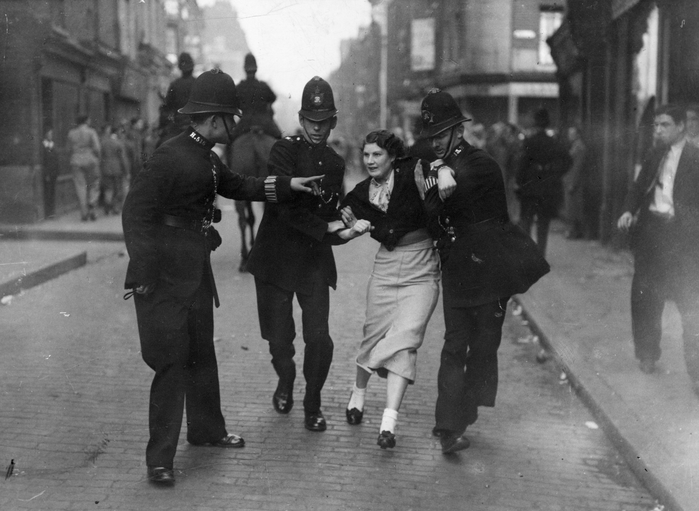 Young woman is taken away by police after the battle of Cable Street