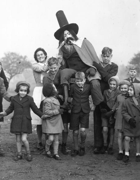 November 1947: The staff and children of the Aldersbrook Children's Home, Wanstead, celebrating Guy Fawkes Day. (Photo by Ron Burton/Keystone/Getty Images)
