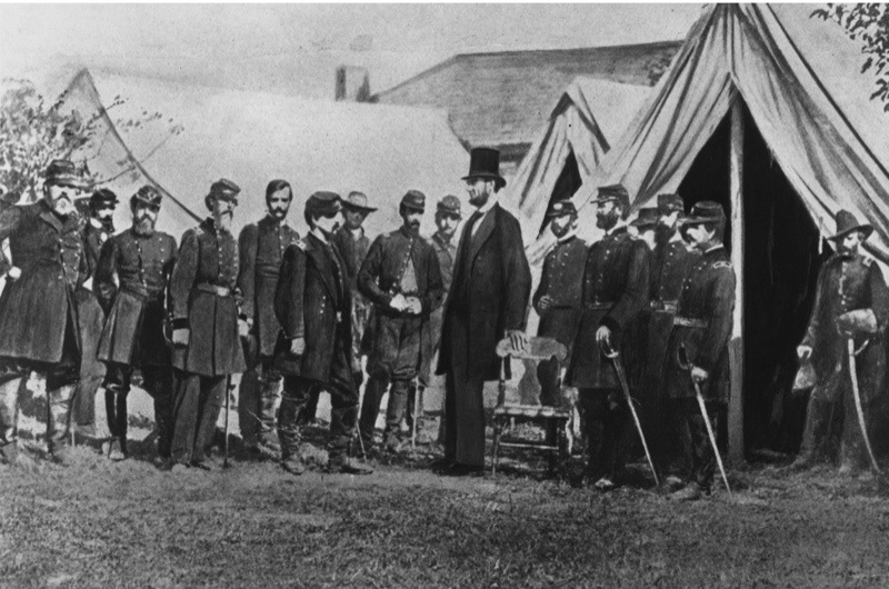 1st October 1862:  President Abraham Lincoln visiting soldiers encamped at the Civil War battlefield of Antietam in Maryland. It was one of the bloodiest in the whole American Civil War.  (Photo by Rischgitz/Getty Images)