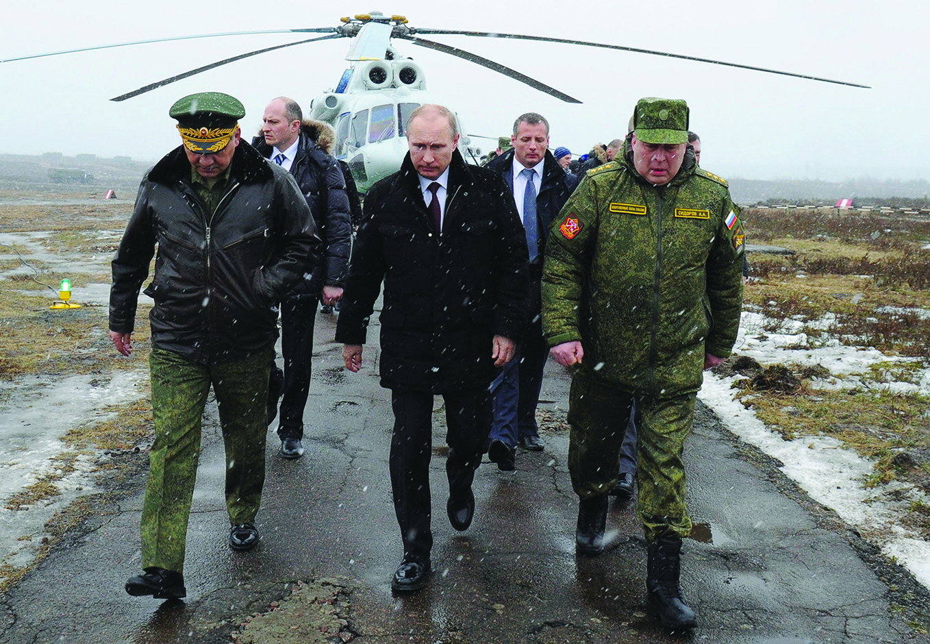 LENINGRAD, RUSSIA - MARCH 3: Russian Head of State Vladimir Putin orders to Russian army to finish drills in west and center military region in Leningrad, Russia on March 3, 2014. According to datas of Russia Ministry of Defence, in order to examine battle readiness of Russian army, 150 thousands of soldiers, 90 warcrafts, helicopters above 120, 880 tank and 1200 military vehicle join to drill. (Photo by Kremlin Press Information Centre/Anadolu Agency/Getty Images)