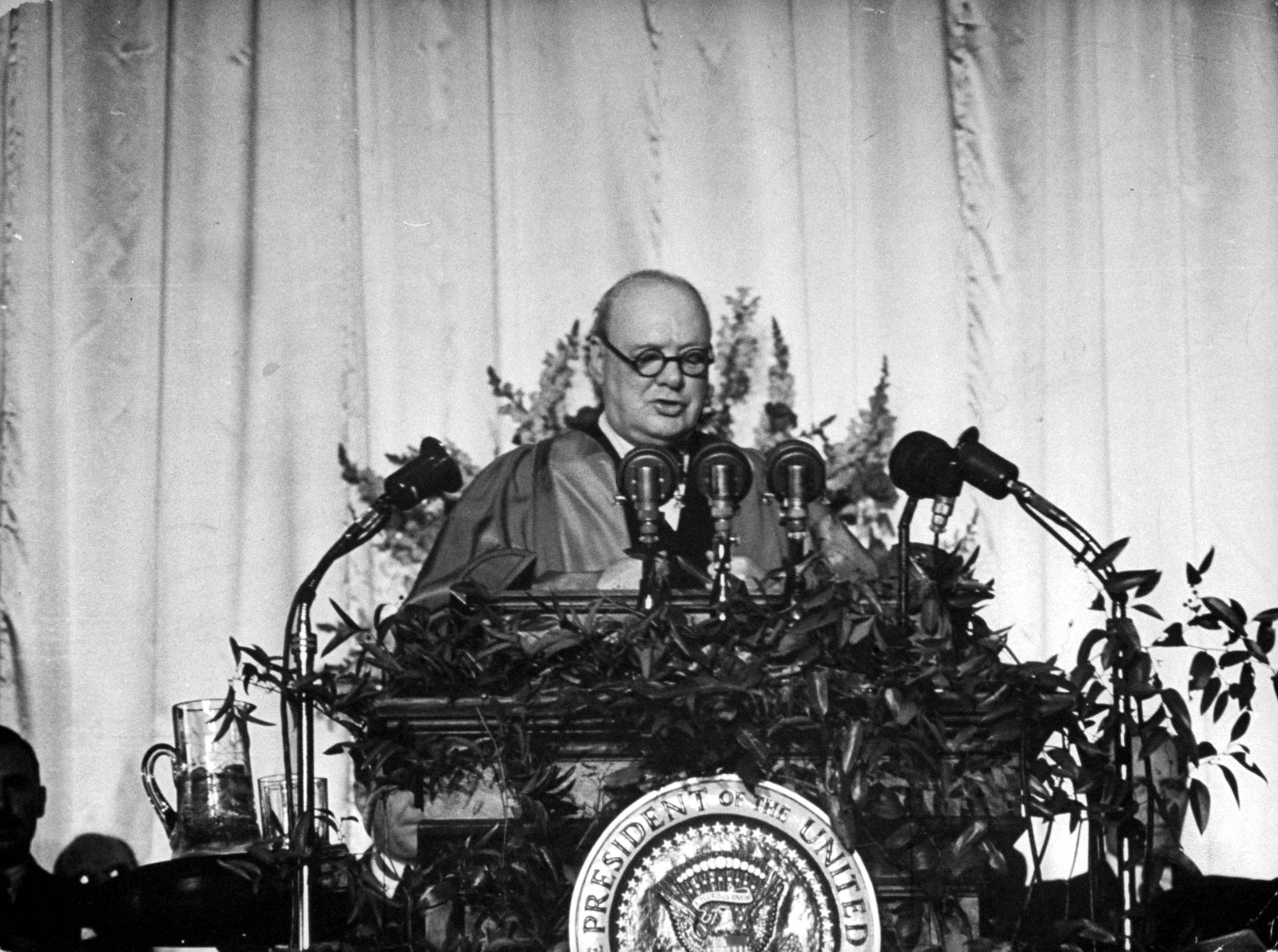 British Prime Minister Winston Churchill delivers a speech at Westminster College that addressed the Communist threat, and in which he uttered the now-famous phrase 'Iron Curtain,' Fulton, Missouri, March 5, 1946. (Photo by George Skadding/The LIFE Picture Collection/Getty Images)
