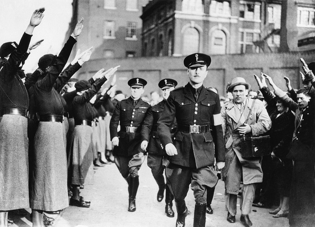 (Original Caption) 10/3/36-London, England: This picture, rushed to the U.S. via the airliner Hindenburg, shows Sir Oswald Mosley, English Fascist leader, ariving and receiving the Fascist salute from his followers, at pint from which a parade of 5,000 Fascists was scheduled to start on Sunday (Oct. 4).