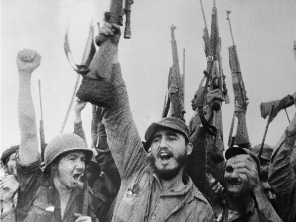 Castro cheering with troops, in a shot from a 1957 television programme