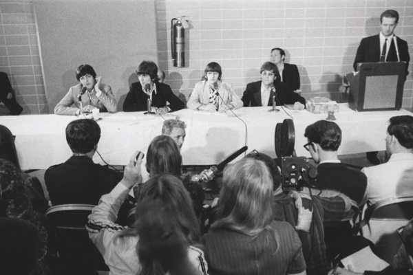 The Beatles answer questions at a press conference, backstage before the show at Memphis Mid-South Colisuem, Memphis, Tennessee, August 19, 1966. L-R Paul McCartney, George Harrison, Ringo Starr, John Lennon with manager Brian Epstein behind. (Photo by Koh Hasebe/Shinko Music/Getty Images)