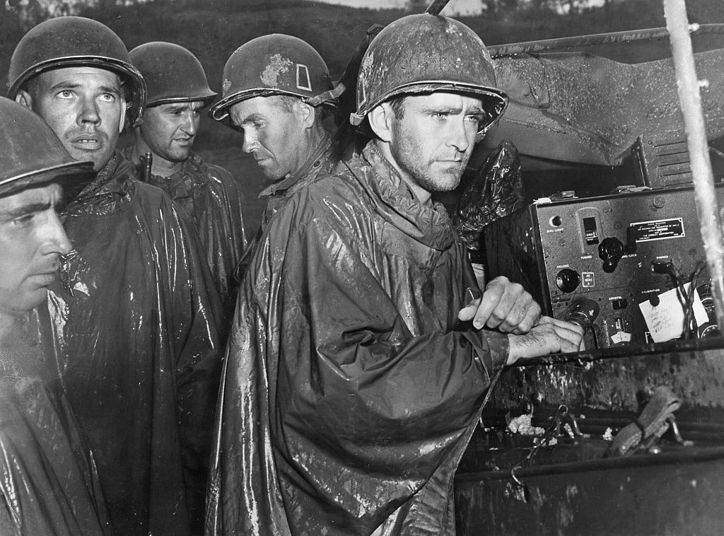 (GERMANY OUT) Japan : Battle of Okinawa Soldiers of the 77th US Infantry Division listening to news on the radio about Nazi Germany's surrender in a shelter near the front - 1945 - Vintage property of ullstein bild (Photo by ullstein bild/ullstein bild via Getty Images)