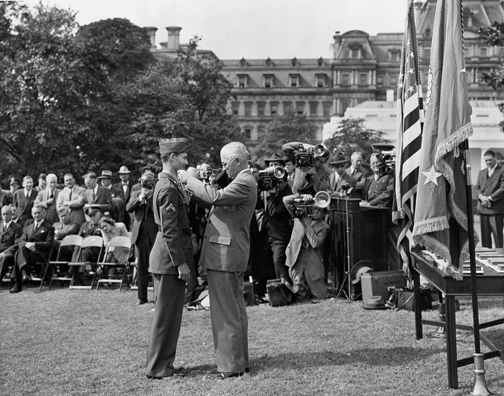 Among the fifteen servicemen awarded the Congressional Medal of Honor at a mass presentation in the White House gardens was Corporal Desmond T. Doss, Lynchburg, VA, shown receiving the Nation?s top award from President Harry S. Truman. Corporal Doss, the only conscientious objector ever to receive the award, earned the citation while serving as medical corpsman with the 77th Division on Okinawa.
