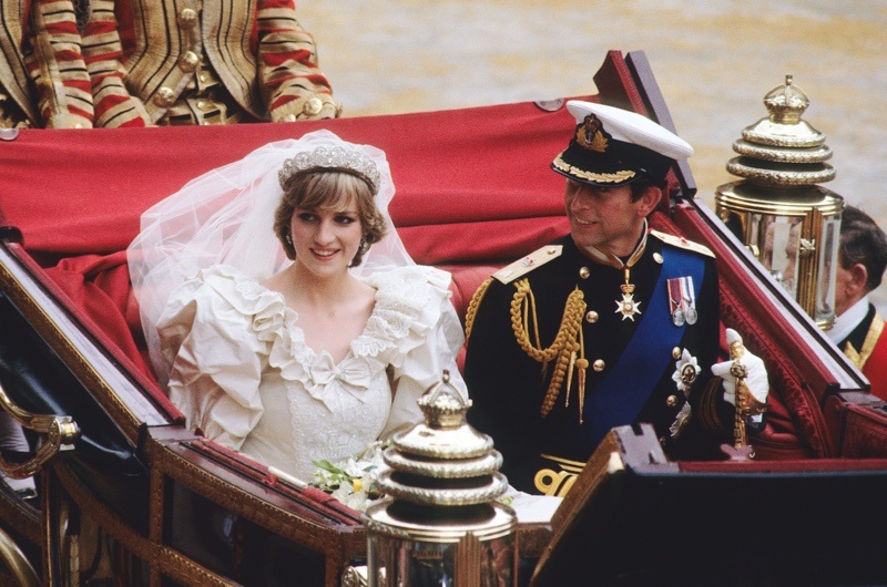 Diana and Prince Charles leave St Paul's Cathedral in a horse-drawn carriage after their wedding on 29 July 1981. (Getty)