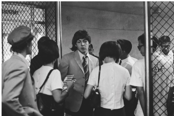 Paul McCartney at Manila International Airport after the Philippines leg of the Beatles' final world tour, 5th July 1966. The group made a hasty exit from the country after a perceived snub on President Ferdinand Marcos and his wife Imelda resulted in official hostility, including the withdrawal of police protection for the group. (Photo by Robert Whitaker/Getty Images)