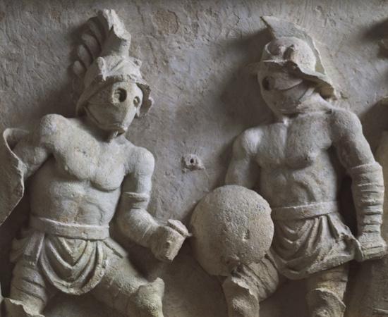 Stone carving of Roman gladiators.