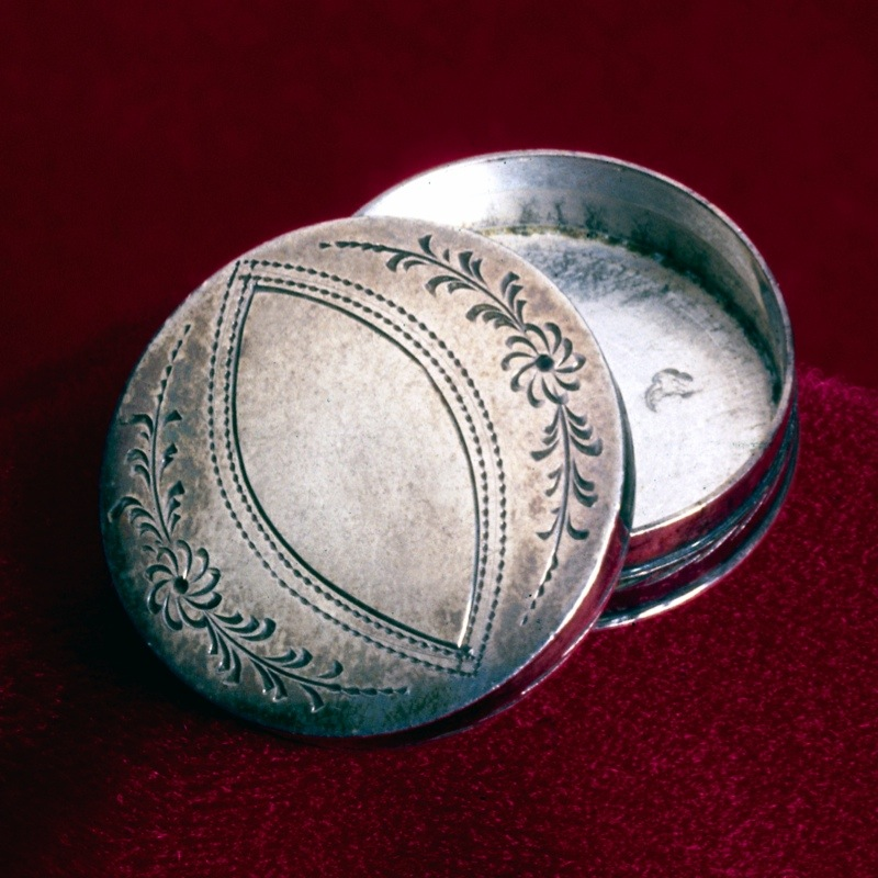 UNITED KINGDOM - JANUARY 03: Cylindrical box made in Birmingham, possibly by Joseph Taylor. It would have contained pills, cachous (lozenges to sweeten the breath), or patches to cover smallpox scars. In the 18th century the area around Birmingham became famous for its metalwork shops, producing all kinds of decorative metal goods. (Photo by SSPL/Getty Images)