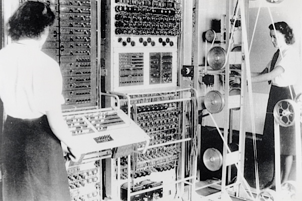 Picture number: COM/B911217 Description: Wrens operating the 'Colossus' computer, 1943. Colossus was the world's first electronic programmable computer, at Bletchley Park in Bedfordshire. Bletchley Park was the British forces' intelligence centre during WWII, and is where cryptographers deciphered top-secret military communiques between Hitler and his armed forces. The communiques were encrypted in the Lorenz code which the Germans considered unbreakable, but the codebreakers at Bletchley cracked the code with the help of Colossus, and so aided the Allies' victory. Credit: Bletchley Park Trust/Science & Society Picture Library All images reproduced must have the correct credit line. Clients who do not print a credit, or who print an incorrect credit, are charged a 100% surcharge on top of the relevant reproduction fee. Storage of this image in digital archives is not permitted. For further information contact the Science & Society Picture Library on (+44) 207 942 4400.