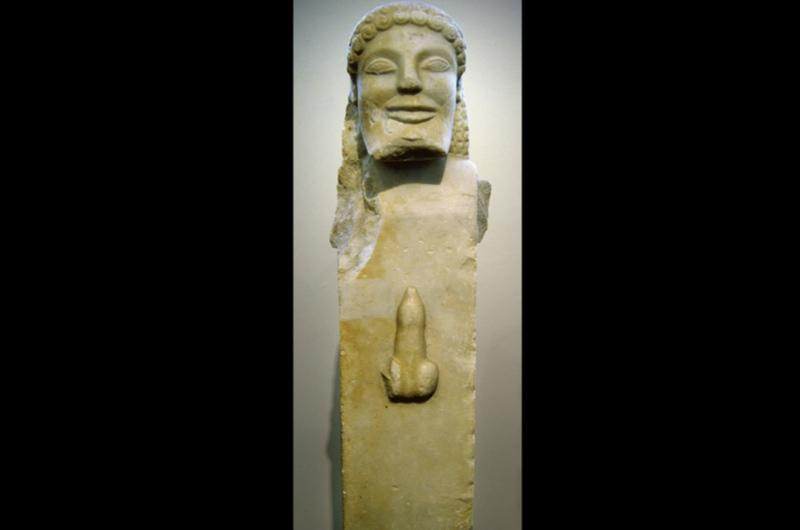 A Greek statue depicting a head and penis.