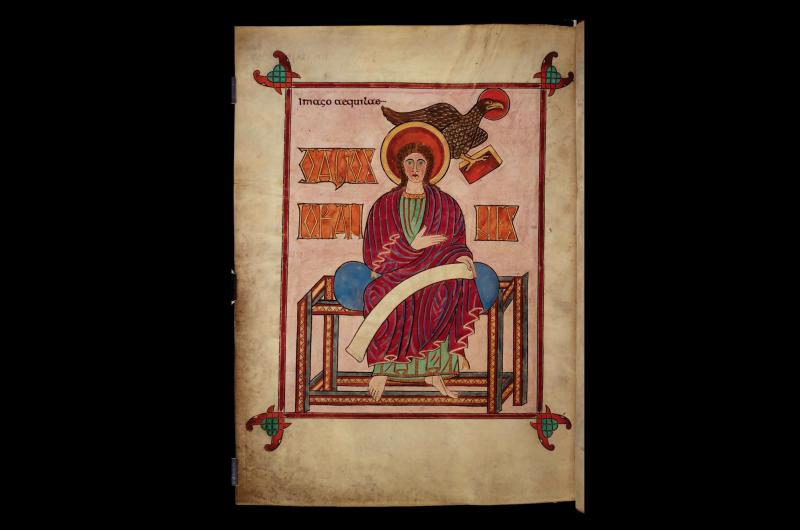 A page from Lindisfarne Gospels depicting John the Evangelist.