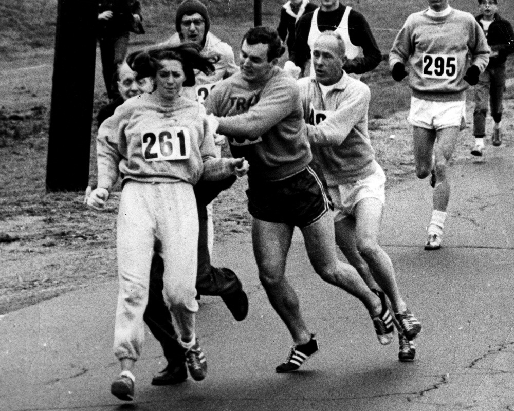 ASHLAND, MA - APRIL 19: Kathy Switzer roughed up by Jock Semple during Boston Mararthon. (Photo by Paul J. Connell/The Boston Globe via Getty Images)