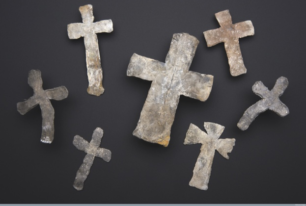 L0058244 Lead mortuary crosses, England, 1300s and 1600s Credit: Science Museum, London. Wellcome Images images@wellcome.ac.uk http://wellcomeimages.org How did graveyards and cemeteries cope with the vast number of burials during epidemics such as the Black Death? Most often bodies were piled in mass burial pits deep underground. Found during the excavation of a London cemetery, these lead crosses were said to have lain with victims of the Black Death outbreak of 1348-53.  What were they for? Do they represent faith at a time of fear and crisis? Or were they used simply as markers? Experts say that medieval burial crosses were believed to protect the bodily remains. These ones are pretty basic in design and production ñ undecorated, with irregular edges and a battered surface. Were they made in a hurry because of the rapid burial of plague victims?  Archaeologists Barney Sloane and Bruce Watson offer another explanation. Reviewing the evidence, they observed that the crosses were not found in mass burial pits but in smaller shafts suggestive of an institutional system of burial. They concluded that the bodies were most likely prisoners from nearby Newgate Gaol who had died of ëgaol distemperí, or typhus, in the 1700s.   And the crosses? Since no other lead burial crosses of this date have been reported, and documentary evidence is not yet found, Sloane and Watson can only speculate. Made by unskilled hands, perhaps the prisoners produced them for dying inmates, or themselves? We may never know the details of the makers or the recipients, but itís certain that each cross will have its own unique story.  maker: Unknown maker  Place made: England, United Kingdom made: Unknown Published:  -   Copyrighted work available under Creative Commons Attribution only licence CC BY 4.0 http://creativecommons.org/licenses/by/4.0/