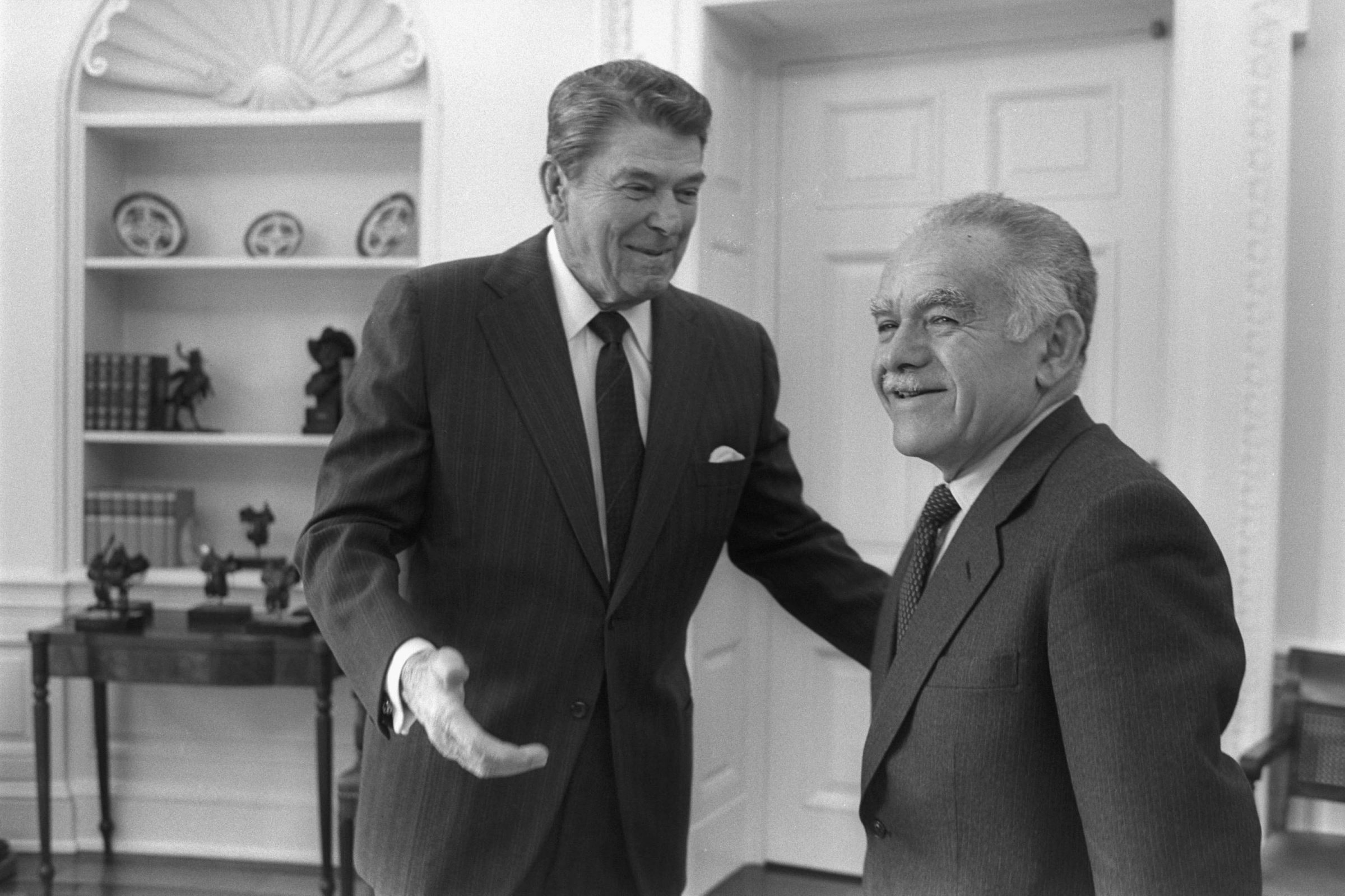 President Ronald Reagan and Israeli Prime Minister Yitzhak Shamir meet in the White House, 18 February 1987. (Photo by Herman Chanania/GPO via Getty Images)