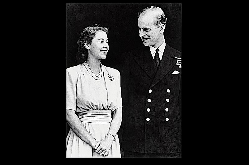 A young Prince Philip and Princess Elizabeth smile at each other in this photo taken on the day of their engagement.
