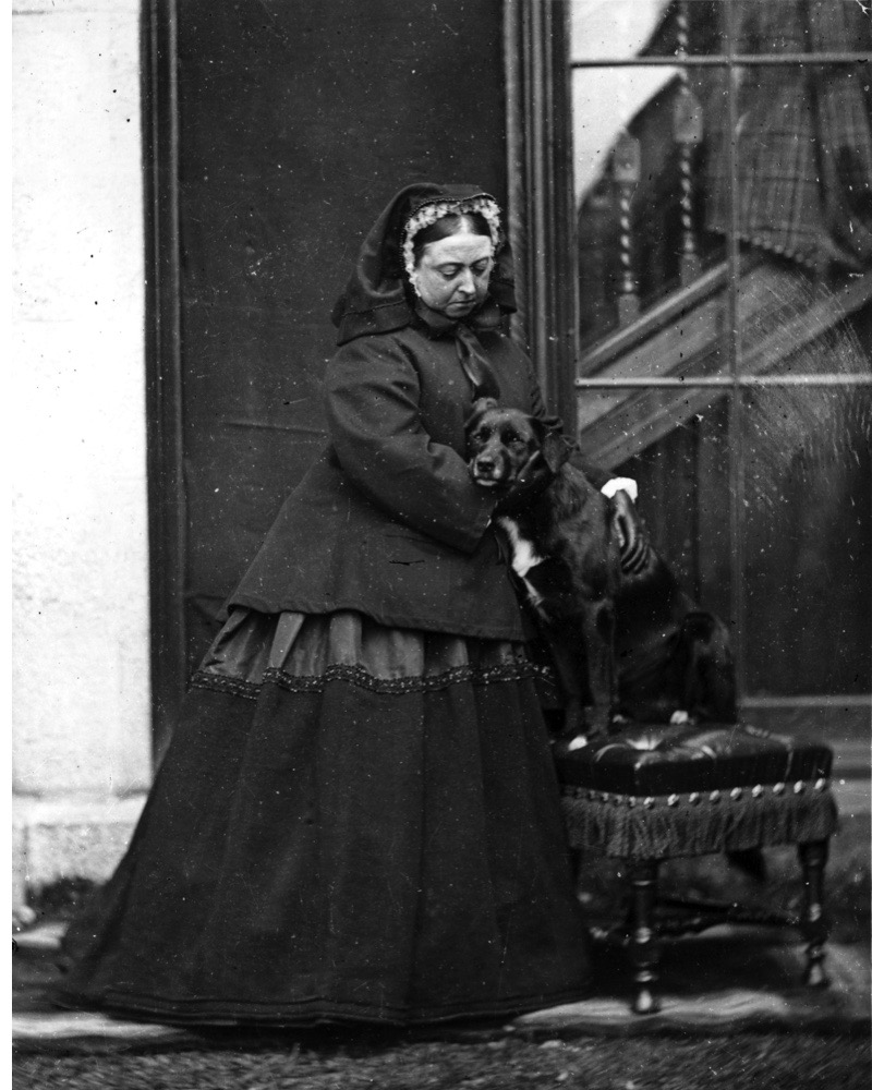 1867:  Queen Victoria of Great Britain (1819 - 1901) with her pet dog 'Sharp' at Balmoral Castle in Scotland.  (Photo by W. & D. Downey/Getty Images)